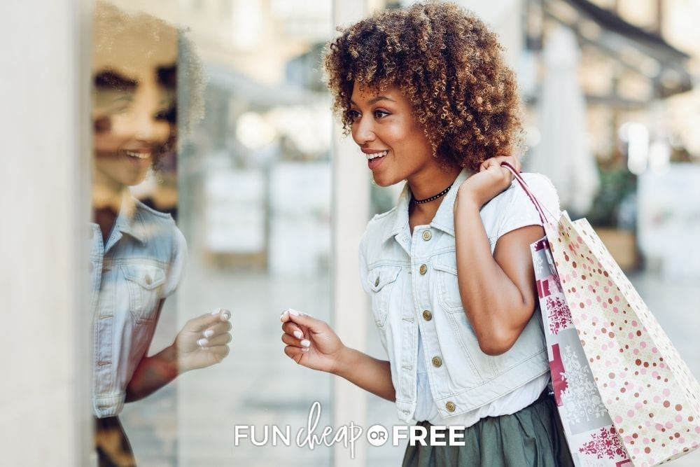 Woman looking into store window from Fun Cheap or Free.