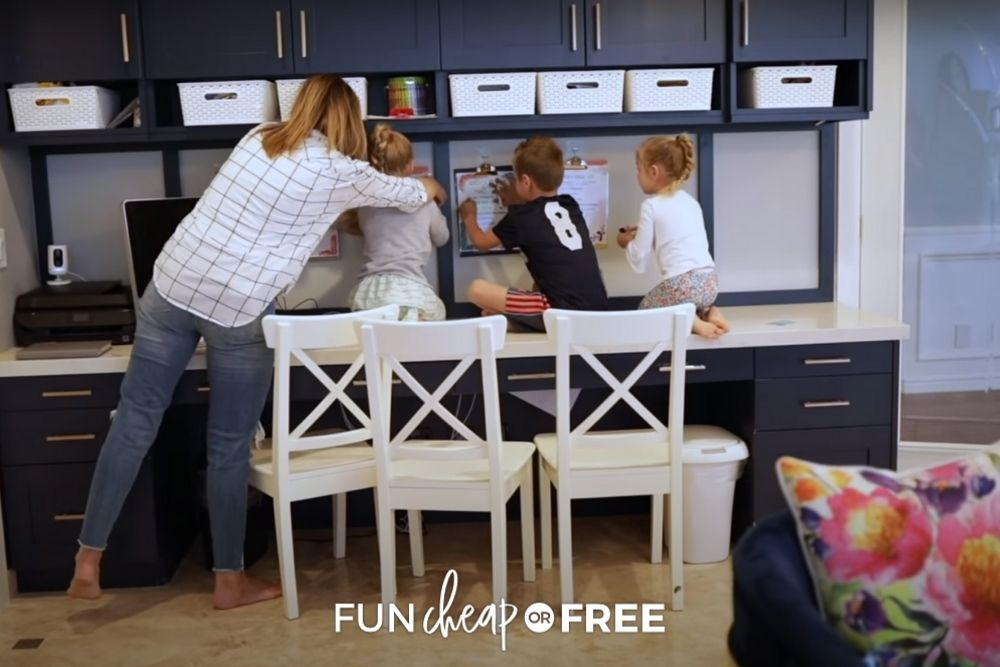 mom and 3 kids at homework station, from Fun Cheap or Free