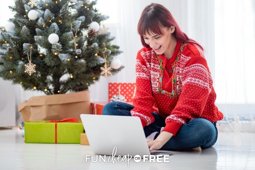 Woman making Christmas cards on the computer from Fun Cheap or Free.