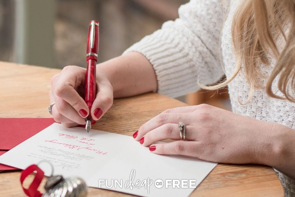 Woman writing Christmas cards from Fun Cheap or Free.