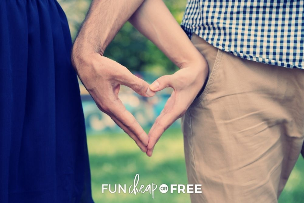 Couple making a heart with their hands from Fun Cheap or Free.