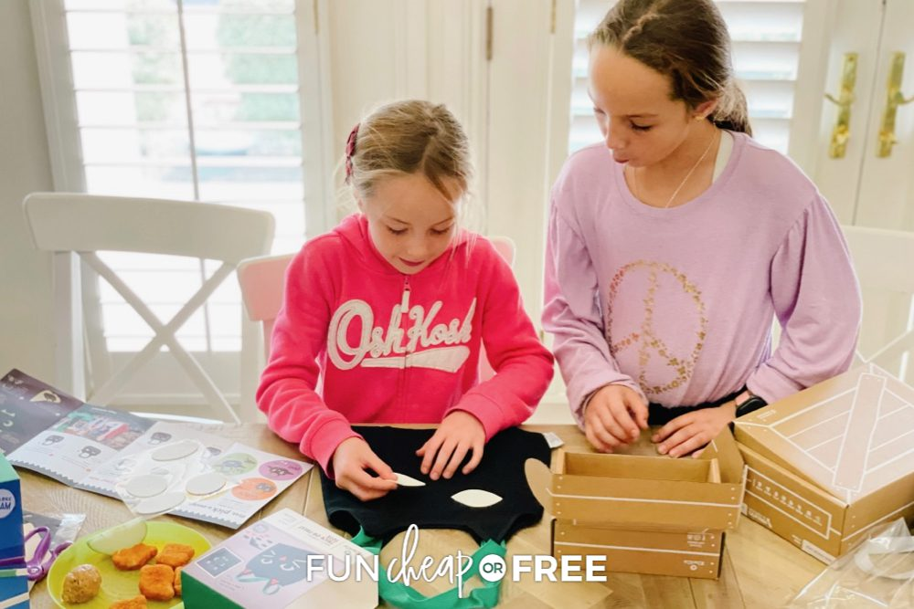 Kids putting together Halloween Kiwi Crates from Fun Cheap or Free