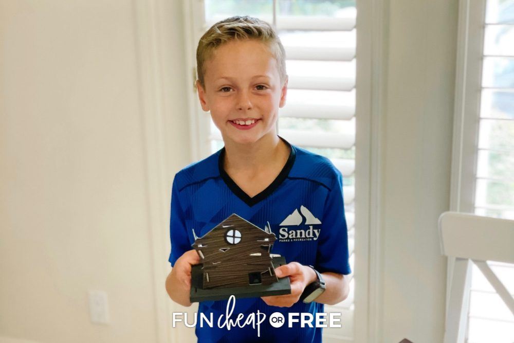 Boy holding Light Up Haunted House from Fun Cheap or Free