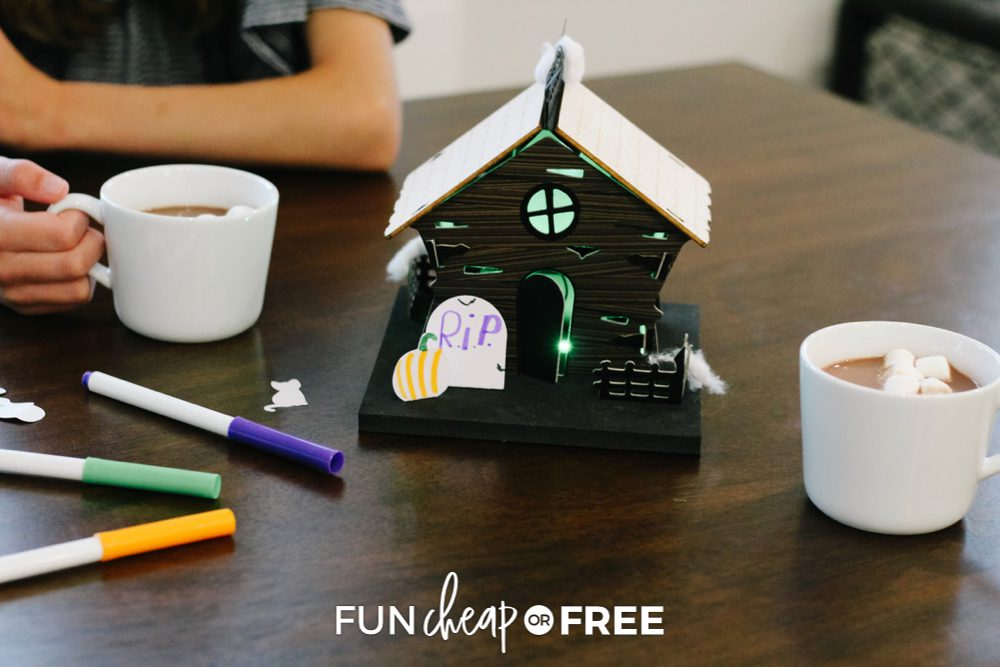 Girl with cup of cocoa, decorating haunted house from Fun Cheap or Free